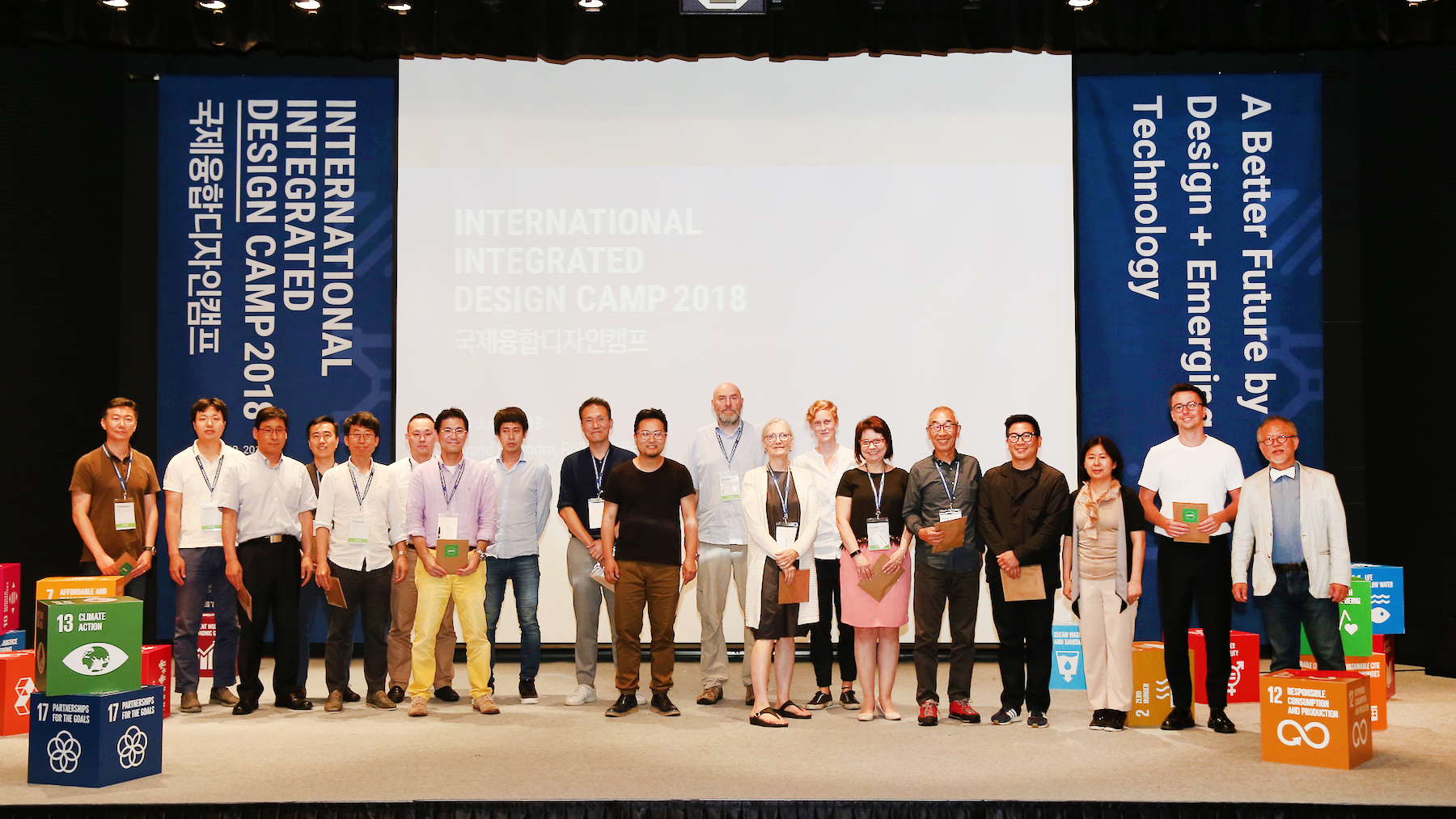 KIDP-IIDC 2018 Day 3 - 180 tutors on stage b.jpg
